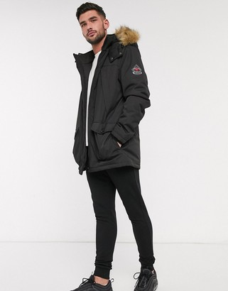 Threadbare parka with faux fur hood in black