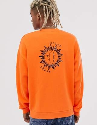 Asos Design DESIGN oversized sweatshirt in bright orange with sun & moon back print