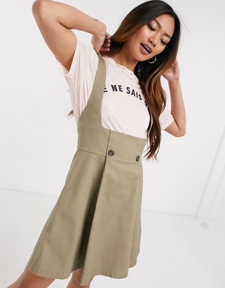 Asos DESIGN mini twill pinafore skirt in stone