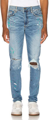 Amiri Paint Splatter Jean in Rosebowl Blue | FWRD