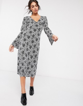 Asos DESIGN plisse midi dress with tie back in black and white floral print