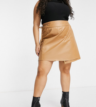 ASOS DESIGN Curve leather look wrap mini skirt with tie detail in tan