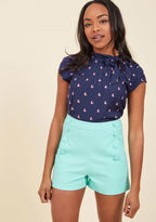 SRA3441 Each time you march these retro, mint shorts to the shore, you know you can at least count on the water to greet you with a friendly wave! Though, with a high waist, rows of glossy buttons secured to scalloped fabric, and petite pockets, this vented pair
