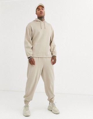 ASOS DESIGN organic oversized tracksuit with hoodie & relaxed sweatpants in beige