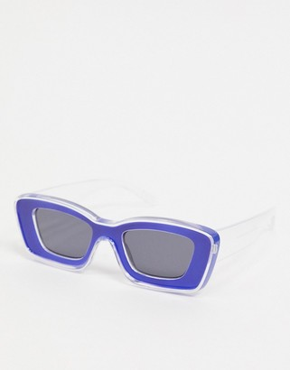 ASOS DESIGN chunky frame bevel sunglasses in clear and blue