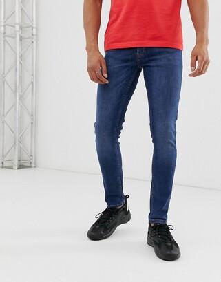 Topman skinny jeans in bright blue wash