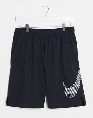 Nike Training shorts with camo swoosh in black