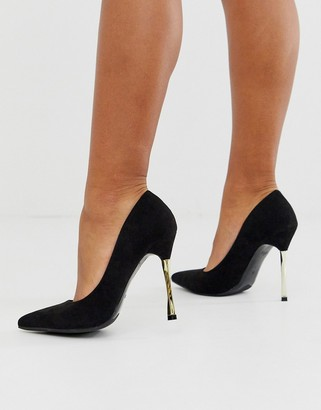 Glamorous black court shoes with gold statement heel