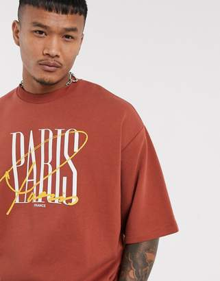 Asos Design DESIGN short sleeve oversized sweatshirt in brown with paris print