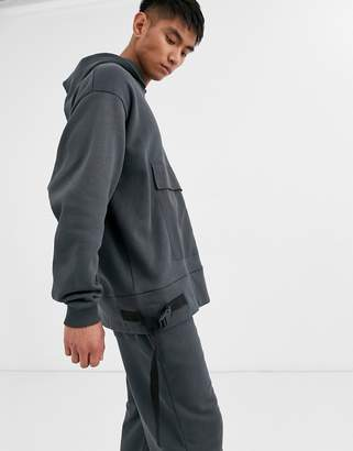 Asos Design DESIGN co-ord oversized hoodie with utility details in washed black