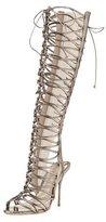 jennifer lopez  Who made  Jennifer Lopezs silver top, fringe skirt, and cage boots?