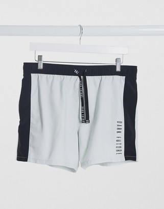 ASOS Dark Future swim shorts with cut and sew design in white