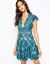 The Jetset Diaries Fantasia Plunge Skater Dress in Teal