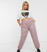 New Girl Order Curve relaxed sweatpants with glitter roses in washed pink