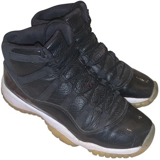 Jordan Air 11 Black Leather Trainers