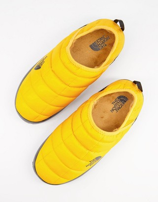 The North Face Thermoball Traction V mule slippers in yellow