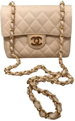 Chanel Beige Cloth Handbags