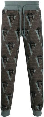 Undercover x Valentino logo print track pants