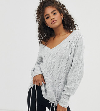 Asos DESIGN Tall v neck cable sweater with tie detail in recycled blend