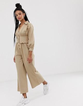 ASOS DESIGN frill waist button front linen jumpsuit