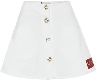 Gucci Appliqued denim A-line miniskirt