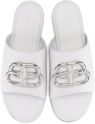 Balenciaga Oval BB Slides in White & Silver | FWRD