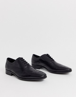Office macro brogue in black leather