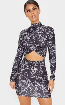 PrettyLittleThing Abstract Faces Print Long Sleeve High Neck Ruched Cut Out Bodycon Dress