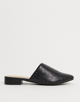 Truffle Collection flat mules in black