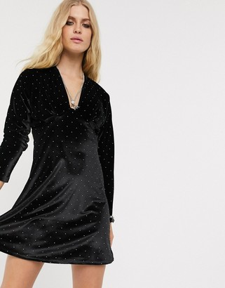 ASOS DESIGN long sleeve plunge velvet mini dress in gold stud