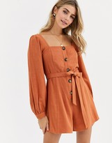 Asos Design DESIGN button front tie waist puff sleeve romper with long sleeves