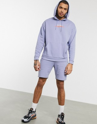 ASOS DESIGN tracksuit in purple with oversized hoodie and slim shorts with text print