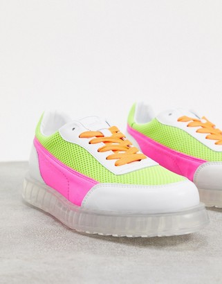 Joshua Sanders low top trainer with transparent sole in neon pink and yellow