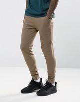 Asos Super Skinny Joggers In Brown