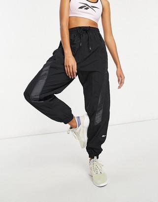 Reebok Training woven tech sweatpants in black