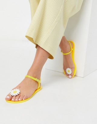 Asos DESIGN Fearless daisy jelly flat sandals in yellow