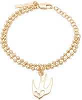 McQ by Alexander McQueen Swallow Bracelet in Metallic Gold.
