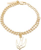 McQ Swallow Bracelet in Metallic Gold.