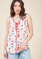 Mct1329 You keep the vibe on set perpetually positive, and the quirky ice pop print of this white blouse only adds to the ambiance! With red piping, a bow-topped V-neckline, and a round-up of red, white, blue, and peach hues, this ModCloth namesake label top take