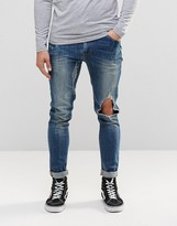 Asos Super Skinny Jeans With Open Rips In Mid Blue