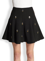 taylor swift  Who made  Taylor Swifts black short sleeve top and mini skirt?