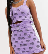 One Above Another mini skirt in scorpion monogram denim with embellishment co-ord