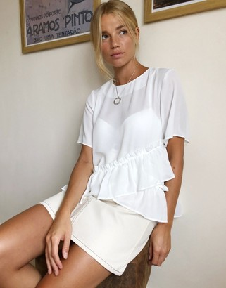 Asos DESIGN woven t-shirt with ruffle hem in ivory