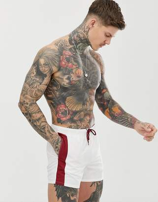 Asos Design DESIGN swim shorts in white with contrast burgundy side stripe in short length-Red