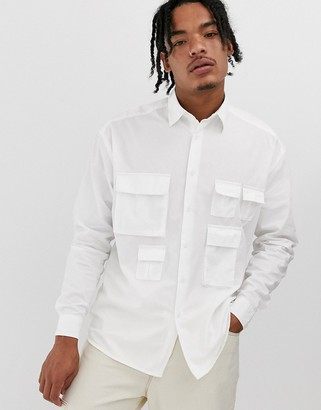Asos Design DESIGN oversized white poplin shirt with utility pockets in white
