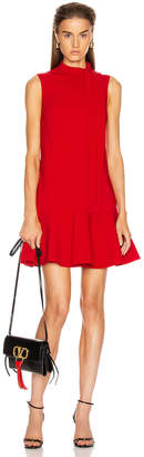 Valentino Sleeveless Peplum Dress in Red | FWRD