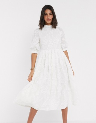 Asos DESIGN Premium broderie midi smock dress with lace up back in cream