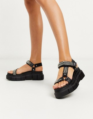 Truffle Collection chunky chain sandals in black