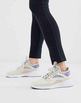 Reebok Training freestyle motion lo trainers in blue and pink