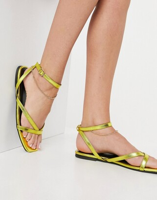 ASOS DESIGN Flames flat sandals with ankle chain in gold